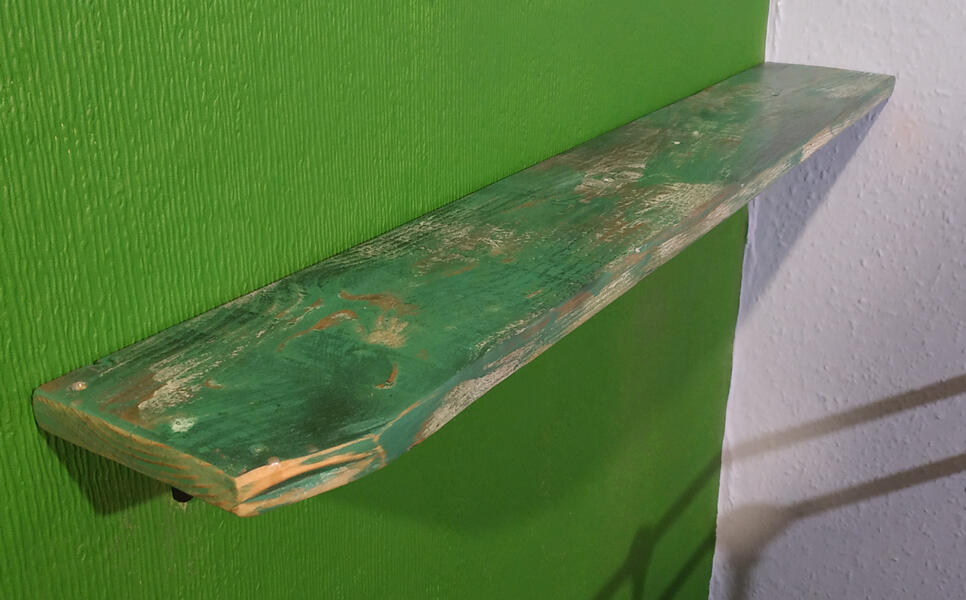Mounted shelf with distressed wood and green paint