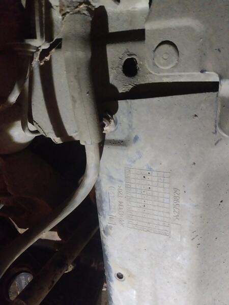 Cowling mounting bolt in wheel well